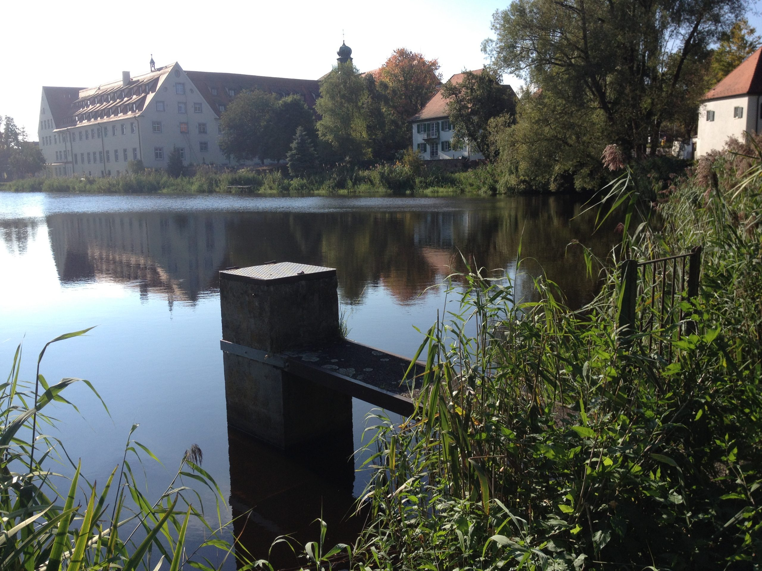 The monastery pond in Wald, east view from the dam with monk. Source: Zollernalb, Wikimedia Commons (CC BY-SA 4.0) Location: Monastery St. Lioba.